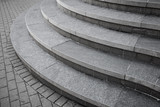 Curved modern gray stone stairs in the city