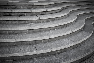 Seven curved modern gray stone stairs in the city