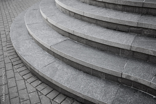 Aluminium Trappen Curved modern gray stone stairs in the city