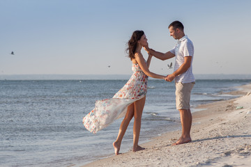 Romantic shot of young couple on the beach