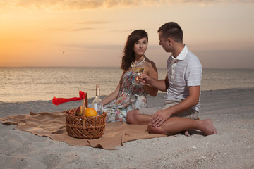 Beautiful Couple On Beach With Wine Picnic