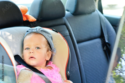 baby girl  in car