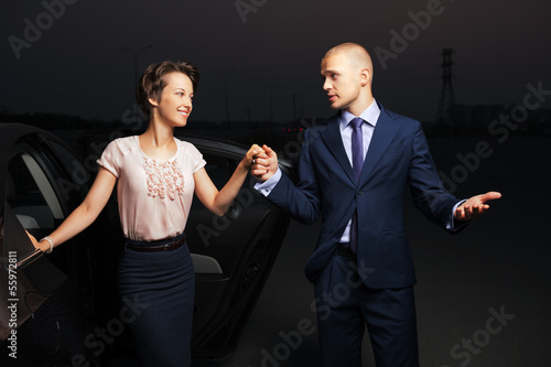 Young business couple at the car