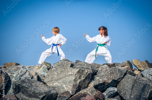 Children training karate on the stone coast