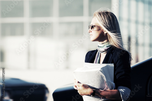 Young business woman with financial papers