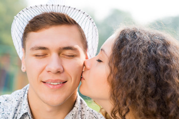girl kissing a man on the cheek