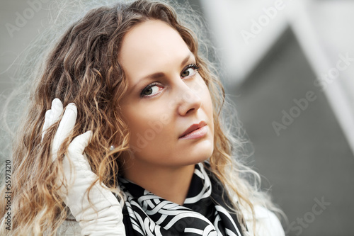 Sad beautiful woman with long hair