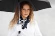 Sad beautiful woman with umbrella