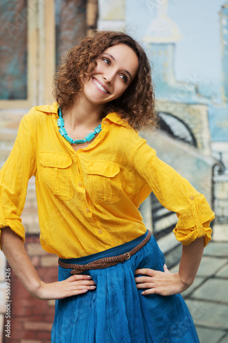 Happy young woman with curly hairs