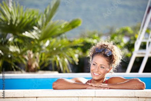 Young woman relaxing in the water. Summer.
