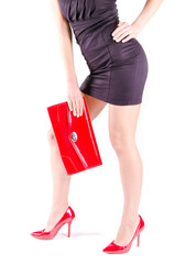 Beautiful womanish  legs in red shoes and mini bag
