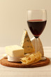 Composition with wine,various types of  cheese  on wooden table