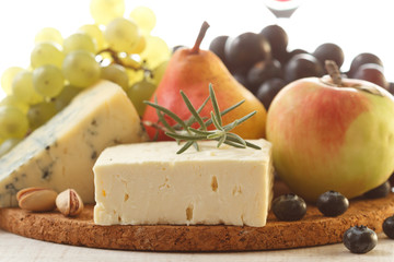 Various types of cheese and fruits composition