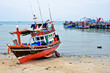 Fishing boats moored at jetty.