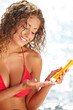 Young beautiful happy smiling cheerful tanned woman with sun-pro