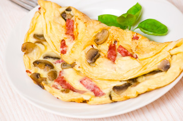 Omelet with mushrooms and salami