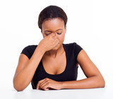 stressed african businesswoman having headache