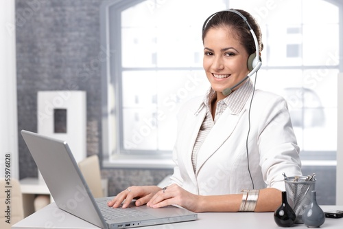 Happy call dispatcher with laptop