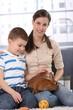 Little kid with mum caressing rabbit pet