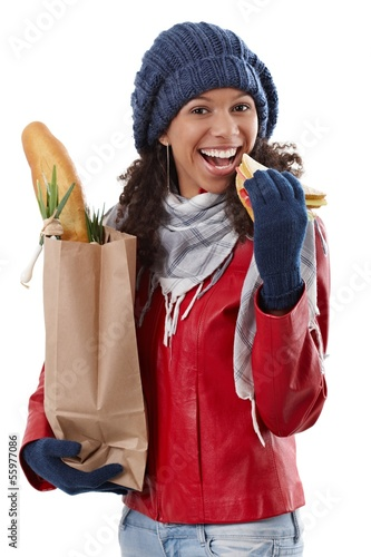 Happy girl with shopping bag and sandwich