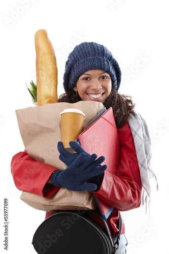 Happy woman carrying loads