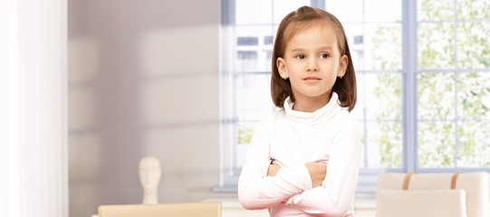 Cute little girl arms crossed