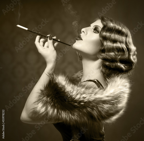 Smoking Retro Woman. Vintage Styled Black and White Photo - 55978232
