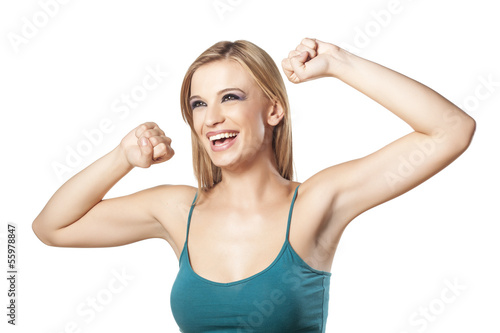 happy smiling girl with her hands up and clenched fists