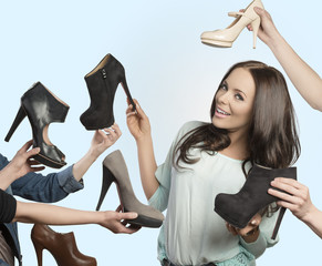 smiling girl with assortment of shoes