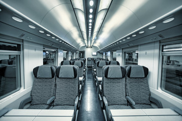 Modern train coach interior view.
