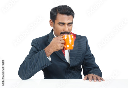 Indian Businessman drinking coffee