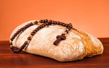 rosary and bread