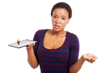 unhappy african american woman holding tablet computer