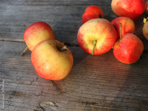 Red apples on a wooden surface