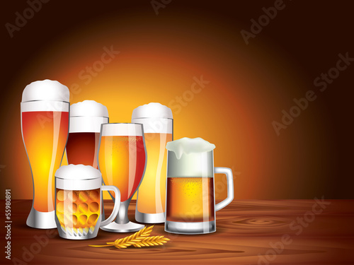Beer glasses on wooden table, dark background