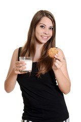 teen girl with glas milk and oatmeal cookie