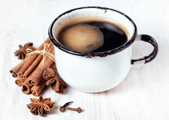 Old cup of coffee and spices