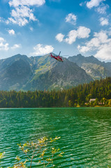 Rescue Helicopter and Beautiful Lake in High Tatra of Slovakia