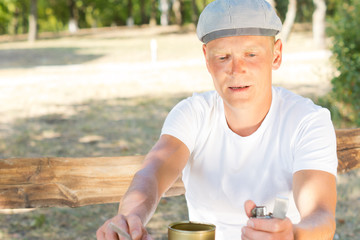 Man about to light a cigarette