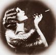 Smoking Retro Woman. Vintage Styled Black and White Photo