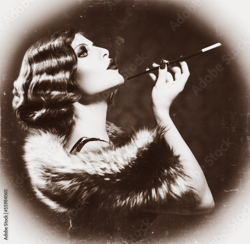 Smoking Retro Woman. Vintage Styled Black and White Photo