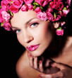 Woman with rose flowers hairstyle
