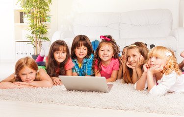 Kids on the floor with laptop