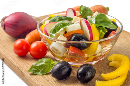 Salad with vegetables around isolated on white background
