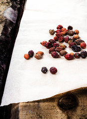 Dried briar or berry Rose hips on vintage wooden background.  He