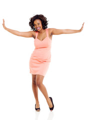 african woman with arms outstretched