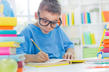 little scientist with glasses writing