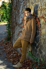 Attractive young handsome man, model of fashion in urban backgro