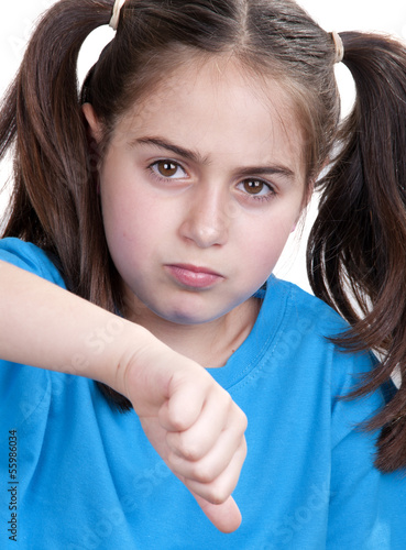little girl showing thumbs up against white background