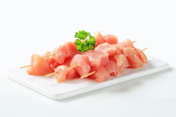 Raw chicken skewers